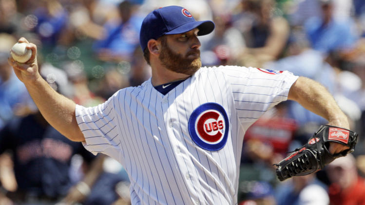 Chicago Cubs starter Ryan Dempster delivers a pitch against the Boston Red Sox  during the second inning of an interleague baseball game in Chicago, Friday, June 15, 2012. (AP Photo/Nam Y. Huh)