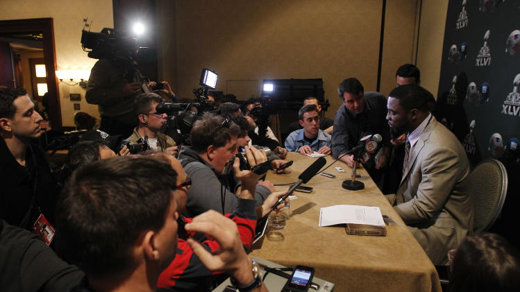 New York Giants' Justin Tuck, right, talks to the media during a news conference, Monday, Jan. 30, 2012, in Indianapolis. The Giants will face the New England Patriots in the NFL football Super Bowl XLVI  on Feb. 5.(AP Photo/Eric Gay)
