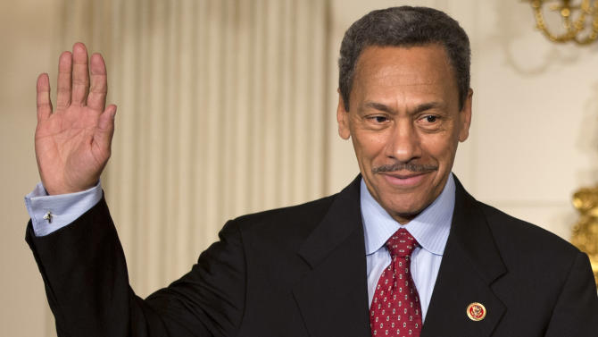 FILE - In this May 1, 2013, file photo, President Barack Obama's nominee for the Federal Housing Finance Authority director Rep. Mel Watt, D-N.C., waves during the announcement of his nomination in the State Dining Room of the White House in Washington. Democrats are struggling to halt a Republican blockade against Obama's pick of Watt and of Patricia Millett for the U.S. Court of Appeals for the District of Columbia. (AP Photo/Jacquelyn Martin, File)