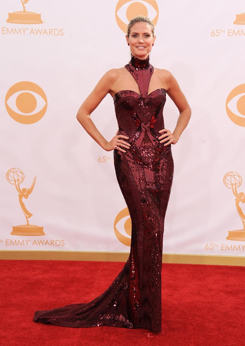 Heidi Klum, wearing Versace, arrives at the 65th Primetime Emmy Awards at Nokia Theatre on Sunday Sept. 22, 2013, in Los Angeles. (Photo by Jordan Strauss/Invision/AP)