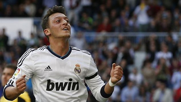 Real Madrid's Mesut Ozil celebrates his goal during the match against Real Betis (Reuters)