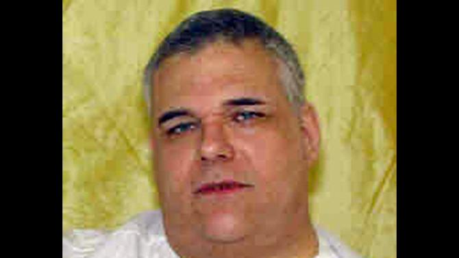 FILE - This undated file photo provided by the Ohio Department of Rehabilitation and Corrections shows death row inmate Ronald Post. Post, the Ohio inmate whose 450-pound weight became an issue in his death penalty case, has died seven months after being granted clemency, officials said Friday, July 26, 2013. (AP Photo/Ohio Department of Rehabilitation and Corrections, File)
