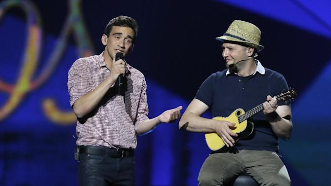 """Gianluca of Malta performs his song """"Tomorrow"""" with his band during a rehearsal for the final of the Eurovision Song Contest at the Malmo Arena in Malmo, Sweden, Friday, May 17, 2013. The contest is run by European television broadcasters with the event being held in Sweden as they won the competition in 2012, the final will be held in Malmo on May 18. (AP Photo/Alastair Grant)"""