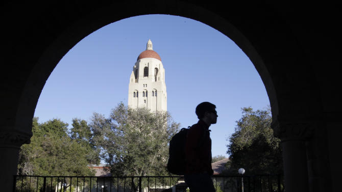 FILE - In this Feb. 15, 2012 file photo, a Stanford University student walks in front of Hoover Tower on the Stanford University campus in Palo Alto, Calif.  Stanford University became the first school to raise $1 billion in a single year, according to an annual college fundraising report released Wednesday, Feb. 20, 2013 that shows that elite institutions continue to grab a disproportionate share of donor dollars. (AP Photo/Paul Sakuma, File)