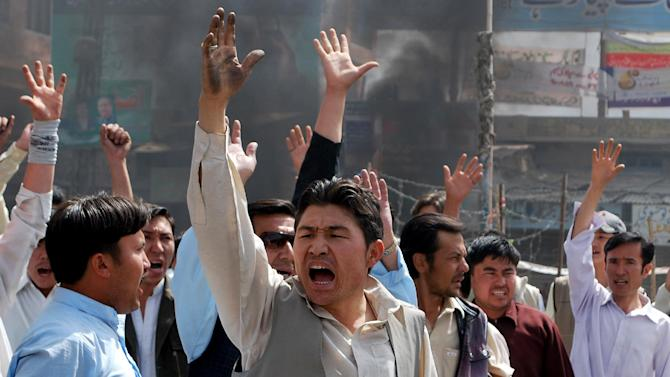 Pakistani protesters shout slogans against government to condemn killings in Quetta, Pakistan, on Thursday, March 29, 2012, after an attack by a gunman who appeared to target local employees of the United Nations Food and Agriculture Organization, officials said. In two attacks seeming to target the UN organization gunmen killed six people on Thursday. (AP Photo/Arshad Butt)