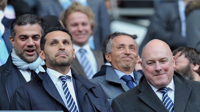 Manchester City Chairman Khaldoon Al Mubarak (L) Watches His Team Challenge Manchester United In Their English Premier AFP/Getty Images