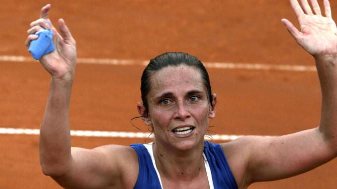 Italy's Roberta Vinci celebrates after winning the Fed Cup tennis final match against Russia's Alexandra Panova, in Cagliari, Italy, Saturday, Nov. 2, 2013. Vinci won 5-7, 7-5, 8-6. (AP Photo/Max Solinas)
