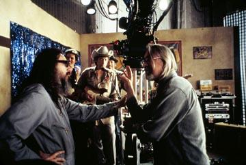 Larry Charles (left) directs a scene with Bob Dylan in Sony Pictures Classics' Masked and Anonymous