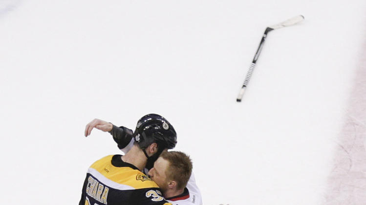 Boston Bruins defenseman Zdeno Chara (33), hugs Chicago Blackhawks right wing Marian Hossa (81), both of Slovakia, after the Blackhawks beat the Bruins 3-2 in Game 6 of the NHL hockey Stanley Cup Finals, Monday, June 24, 2013, in Boston. (AP Photo/Charles Krupa)