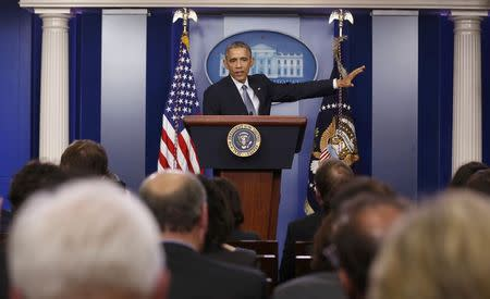 U.S. President Barack Obama reponds to a question during his end of the year press conference in the briefing room of the White House in Washington
