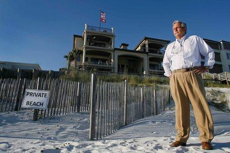 Coastal engineer Anderson stands near the dunes that he created behind former Arkansas Governor Huckabee's house on the Gulf Coast in Santa Rosa Beach