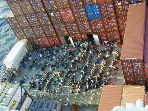 This file photo shows refugees, rescued from a ferry that was stranded in the Indian Ocean, on board of a Norwegian cargo ship, some 120 km off Christmas Island, in 2001.