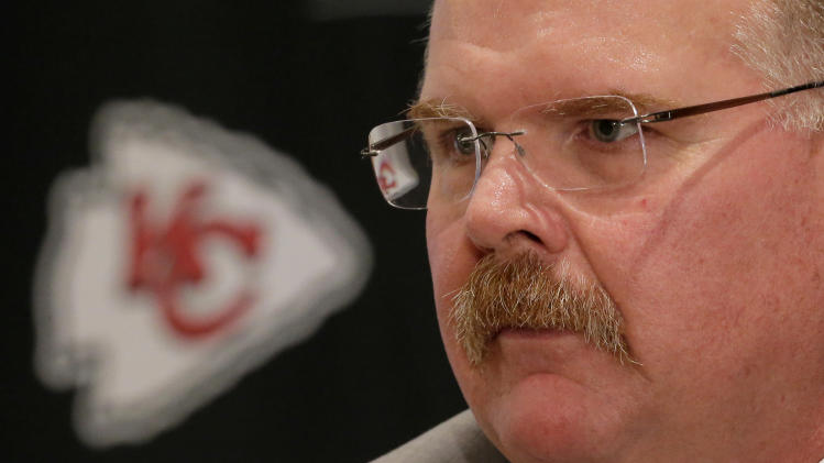 New Kansas City Chiefs NFL team head football coach Andy Reid listens to a question during a news conference at Arrowhead Stadium Monday, Jan. 7, 2013, in Kansas City, Mo. (AP Photo/Charlie Riedel)