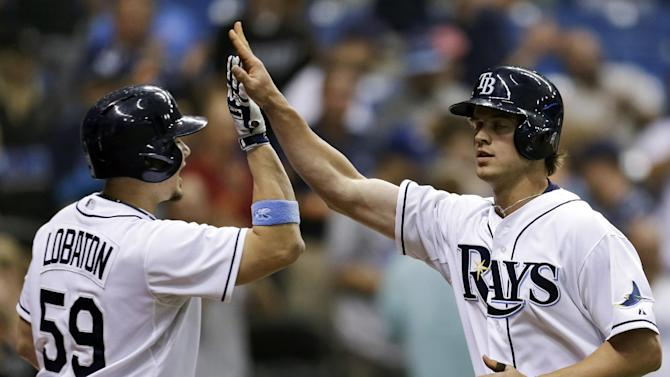 Tampa Bay Rays' Wil Myers, right, high fives on-deck batter Tampa Bay Rays' Jose Lobaton after hitting a second-inning home run off Toronto Blue Jays pitcher Esmil Rogers during a baseball game Monday, June 24, 2013, in St. Petersburg, Fla. (AP Photo/Chris O'Meara)