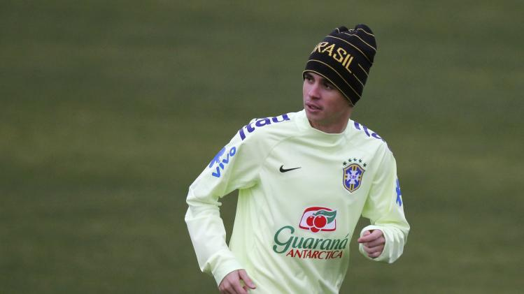 Brazil's national soccer team player Oscar attends a training session in Teresopolis