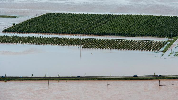 A view from the Radobyl hill shows a highway and a hop garden flooded by the swollen river Elbe near Litomerice, 70 kilometres (43 miles) Northwest of Prague, taken on Wednesday, June 5, 2013. Heavy rainfalls caused flooding in Germany, Austria, Switzerland and the Czech Republic. (AP Photo/CTK, Radek Petrasek) SLOVAKIA OUT