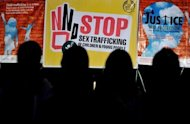 An event is staged to raise awareness over sex trafficking in Manila. Two Swedish men have been jailed for life in the Philippines for human trafficking after they were found running a cybersex den in which women performed acts for Internet clients, authorities said