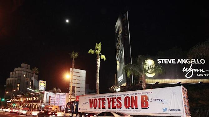 IMAGE DISTRIBUTED FOR AIDS Healthcare Foundation - The 'Yes on B' caravan seen on L.A's famed Sunset Strip after an all day caravan to five cities throughout Los Angeles. The 'Yes on B' caravan covered 137 miles through Hollywood, Long Beach, Northridge, Canoga Park and West Hollywood handing out 150,000 condoms with only ten days before election day on Saturday Oct. 27, 2012, in Los Angeles, Calif. (Photo by Joe Kohen/AP Images for AIDS Healthcare Foundation)