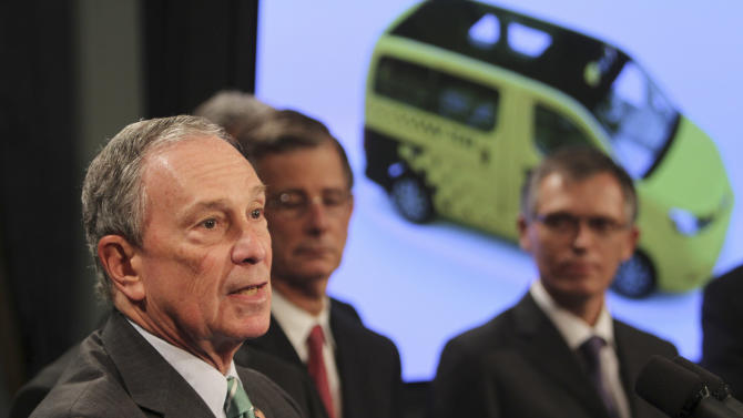 New York City Mayor Michael Bloomberg, left, is joined by Carlos Tavares, right, chairman of Nissan Motor Co.'s Americas operation, as he announces the winner of the Taxi of Tomorrow competition during a news conference at City Hall,  Tuesday, May 3, 2011 in New York. The Nissan NV 200 will be the first taxicab especially built for use in New York City. (AP Photo/Mary Altaffer)