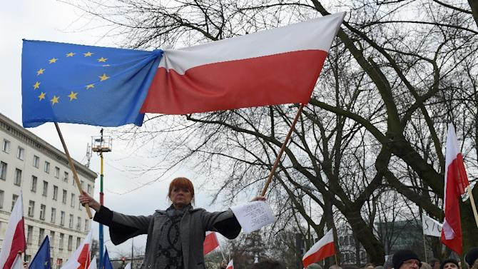 Protesters shout slogans during an anti-government demonstration in Warsaw on December 19, 2015