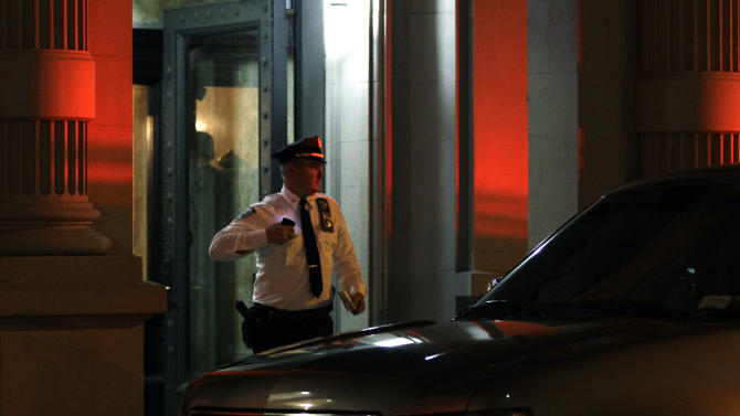 A police officer leaves the luxury Manhattan apartment building where police say a nanny stabbed two small children to death in a bathtub and then stabbed herself in New York, Thursday, Oct. 25, 2012. The nanny, who was found near a knife, was hospitalized in critical condition and was in police custody, and authorities said she is suspected of killing the children, who were pronounced dead at a hospital.  (AP Photo/Kathy Willens)