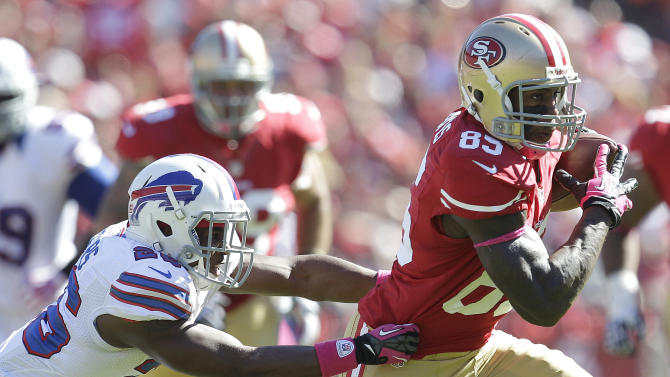 San Francisco 49ers tight end Vernon Davis (85) runs past Buffalo Bills defensive back Justin Rogers (26) during the second quarter of an NFL football game in San Francisco, Sunday, Oct. 7, 2012. (AP Photo/Tony Avelar)