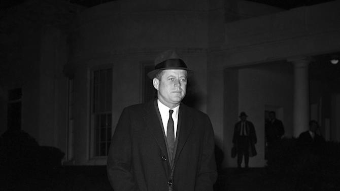 """FILE - In this Dec. 19, 1961 file photo, President John F. Kennedy leaves the White House in Washington to Andrews Air Force Base for flight to Palm Beach, Fla. en route to the bedsite of his father, Joseph P. Kennedy, who is hospitalized after suffering as stroke. Kennedy's civil rights legacy has undergone substantial reassessment since his 1963 assassination. Half a century later, """"We're still trying to figure it out,"""" says one longtime civil rights activist. (AP Photo/WJS)"""