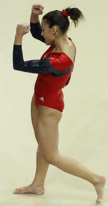 Alicia Sacramone of the U.S. pumps her fists after her beam exercise marking the return to international competition after two years absence during the women's qualifying session for the World Gymnast