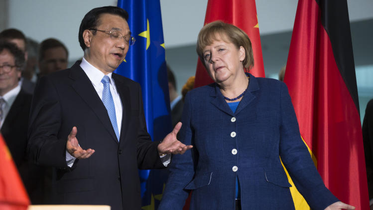 German Chancellor Angela Merkel, right, and the  Chinese Premier  Li Keqiang  gesticulate after a contract signing ceremony  at the chancellery in Berlin, Sunday, May 26, 2013.  (AP Photo/Markus Schreiber)