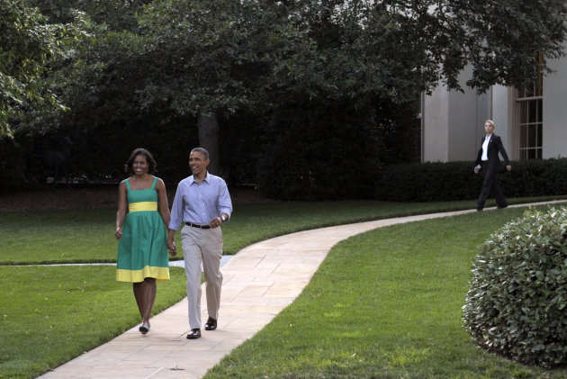 President Barack Obama and first lady Michelle Obama arrive for the Congressional picnic on the South Lawn of the White House in Washington, Wednesday, June 27, 2012. (AP Photo/Susan Walsh)