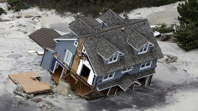 This aerial photo shows a collapsed house along the central Jersey Shore coast on Wednesday, Oct. 31, 2012, over New Jersey. New Jersey got the brunt of Sandy, which made landfall in the state and killed at least six people. More than 2 million customers were without power as of Wednesday afternoon, down from a peak of 2.7 million. (AP Photo/Mike Groll)