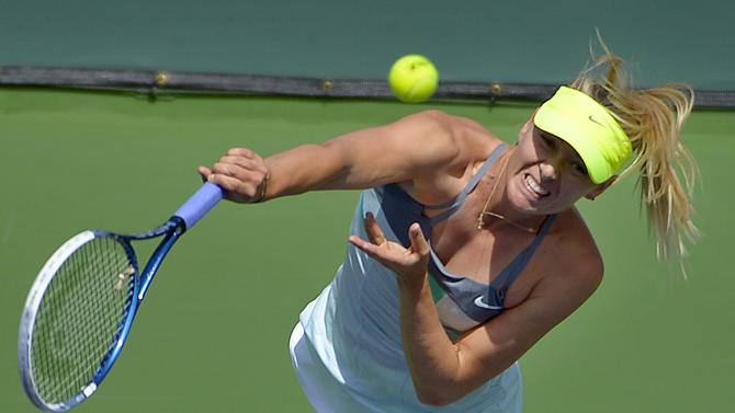 Maria Sharapova, of Russia, serves against Caroline Wozniacki, of Denmark, during their match at the BNP Paribas Open tennis tournament on Sunday, March 17, 2013, in Indian Wells, Calif. (AP Photo/Mark J. Terrill)