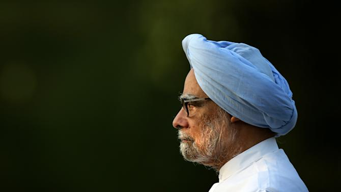 Outgoing Indian prime minister Manmohan Singh leaves after paying homage to former Indian prime minister Rajiv Gandhi on his death anniversary at his memorial, in New Delhi, India, Wednesday, May 21, 2014. Rajiv Gandhi was killed by an ethnic Tamil suicide bomber in May 1991 as he campaigned for a return to the post of prime minister. He was 47 years old. (AP Photo /Manish Swarup)