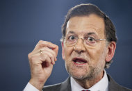 <p>               Spain's Prime Minister Mariano Rajoy, speaks during a press conference after a meeting with Netherlands' Prime Minister Mark Rutte at the Moncloa Palace, in Madrid, Thursday, June 7, 2012. Spain's Prime Minister appeared Thursday to have abandoned his insistence that the country's troubled banking sector will not need an external bailout, as for the first time he avoided ruling out such an option.(AP Photo/Daniel Ochoa de Olza)
