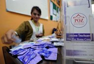 Thanakorn, or Gigi, packs condoms with leaflets before giving them to transgender people at The Poz Home Center in Bangkok. From a cafe near the go-go bars of a Bangkok red light district where she campaigns for safe sex, Gigi gives an unvarnished view of how she joined Thailand's growing ranks of transgender people with HIV