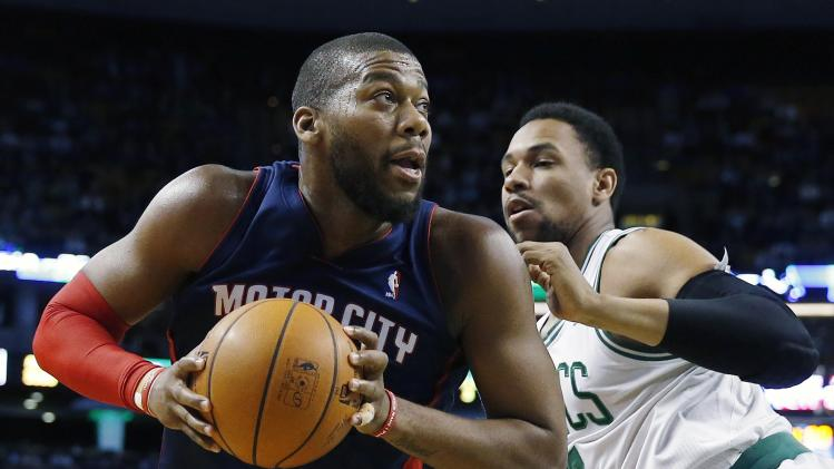Detroit Pistons' Greg Monroe, left, looks to shoot past Boston Celtics' Jared Sullinger, right, in the first quarter of an NBA basketball game in Boston, Sunday, March 9, 2014. (AP Photo/Michael Dwyer)
