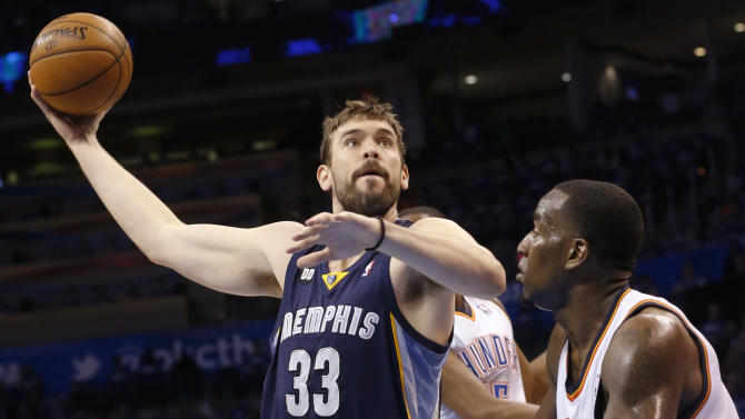 Memphis Grizzlies center Marc Gasol (33) shoots over Oklahoma City Thunder center Kendrick Perkins (5) during the second quarter of Game 1 of their Western Conference Semifinals NBA basketball playoff series in Oklahoma City, Sunday, May 5, 2013. (AP Photo/Sue Ogrocki)