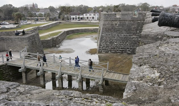 FILE - This Feb. 4, 2005 file photo shows visitors exploring the Castillo de San Marcos in St. Augustine, Fla. The nation's oldest fort was built by Spanish settlers between 1672 and 1695 and used to fight off pirates, hostile natives, French, British, and South Carolinian forces. This year Florida is marking the 500th Anniversary since the explorer Ponce de Leon landed in Florida in April 1513, with a series of events related to the state's Spanish heritage and other aspects of its history. (AP Photo/Amy Sancetta, file)