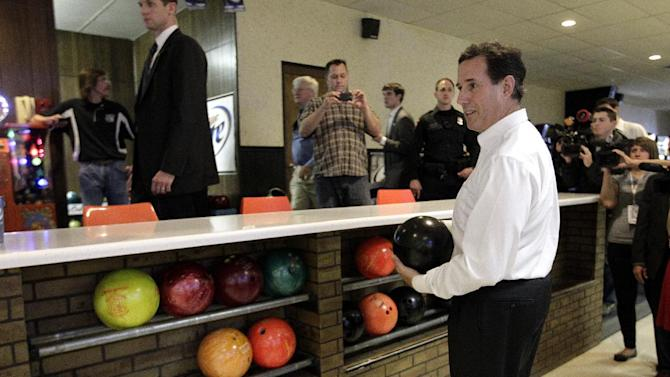 Republican presidential candidate, former Pennsylvania Sen. Rick Santorum looks at bowling balls as he gets ready to bowl at a bowling alley in Fond du Lac, Wis., Sunday, March 25, 2012. (AP Photo/Jae C. Hong)