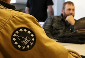 A member of the Pacific Patriot Network wears a patch …