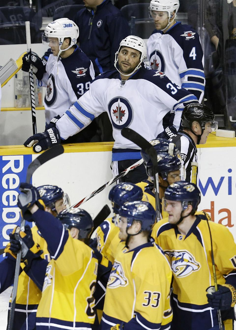 Predators slip past Jets 3-2 in OT
