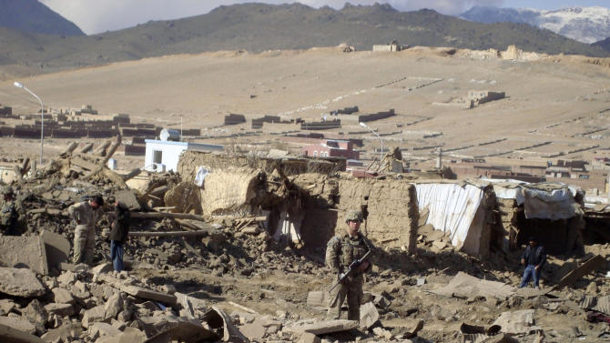 A U.S. soldier stands guard at the site of suicide attack in Wardak Province of Kabul Afghanistan, Friday, Nov, 23, 2012. A suicide attacker detonated a car laden with explosives Friday in eastern Afghanistan, killing several civilians and wounding dozens of others, officials said. Taliban spokesman Zabiullah Mujahid claimed responsibility for the bombing, saying in a statement that the attack was in response to the recent execution of four Taliban detainees at the Afghan government's main detention center in Kabul. (AP Photo/ Mohammed Naser)