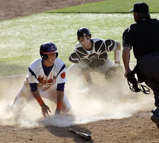 Clemson&#39;s Steve Wilkerson is safe at home plate as South Carolina catcher Dante Rosenberg reacts to the call by the umpire during the sixth inning of an NCAA college baseball tournament regional game in Columbia, S.C., Sunday, June 3, 2012. South Carolina won 4-3. (AP Photo/Mary Ann Chastain)