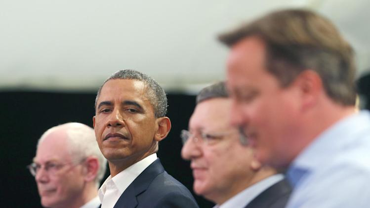 From right, Britain's Prime Minister David Cameron, European Commission President Jose Manuel Barroso, US President Barack Obama and European Council President Herman Van Rompuy attend a media conference regarding EU-US trade at the G-8 summit in Enniskillen, Northern Ireland on Monday, June 17, 2013. British Prime Minister Cameron said he expects formal agreement to launch negotiations on a European-American free trade agreement. He also said a pact to slash tariffs on exports would boost employment and growth on both sides of the Atlantic. (AP Photo/Andrew Winning, Pool)