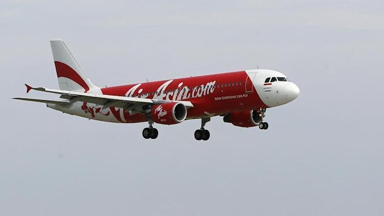 An Indonesia AirAsia Airbus A320-200 passenger prepares to land at Sukarno-Hatta airport in Tangerang
