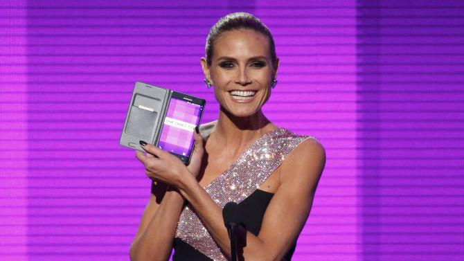 Heidi Klum announces One Direction as Artist of the Year during the 42nd American Music Awards in Los Angeles