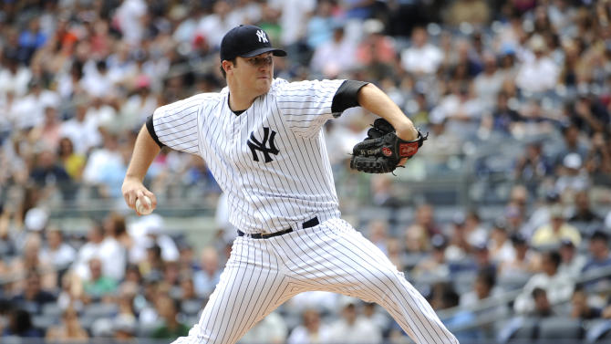 New York Yankees starting pitcher Phil Hughes throws against the Baltimore Orioles in the first inning of a baseball game on Sunday, Sept. 2, 2012, at Yankee Stadium in New York. (AP Photo/Kathy Kmonicek)