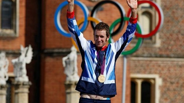Gold medallist Britain's Bradley Wiggins celebrates on the podium during the victory ceremony for the men's cycling individual time trial at the London 2012 Olympic Games at Hampton Court Palace (Reuters)