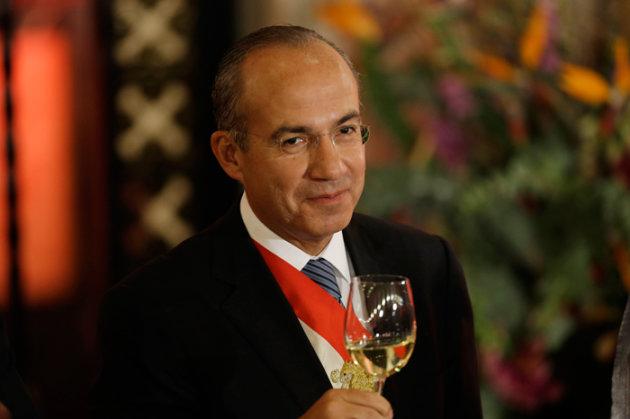 El presidente Felipe Calderón en Palacio Nacional en la cena previo al cambio de gobierno.