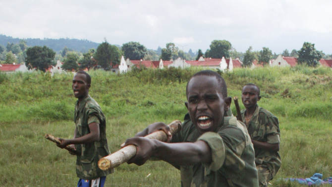 FILE - In this file photo taken on Tuesday, Oct. 23, 2012, M23 rebels conduct training exercises in Rumangabo, eastern Congo. The Rwandan-backed rebel group advanced to within 4 kilometers (2.4 miles) of Goma, a crucial provincial capital in eastern Congo, marking the first time that rebels have come this close since 2008. Congolese army spokesman Col. Olivier Hamuli said the fighting has been going on since 6 a.m. Sunday, Nov. 18, 2012, and the frontline has moved to just a few kilometers (miles) outside the city. (AP Photo/Stephen Wandera,File )